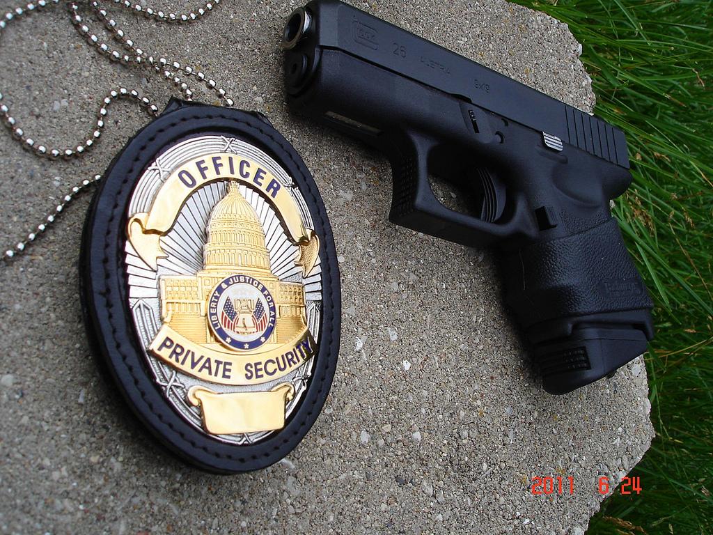armed-security-badge-gun